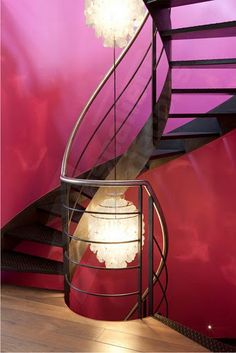 Beautiful modern metal stair case in a pink room with two chandeliers #pinkroom #modernstaircase