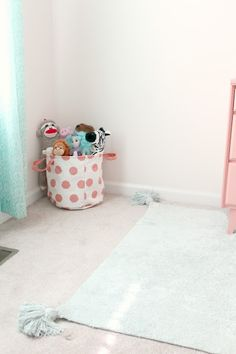 Thank goodness toddler room storage is so cute!