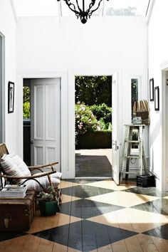 An oversized-diamond floor pattern makes for a high-impact entryway — and all you need to pull it off is a little bit of paint.