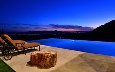 This stunning outdoor pool space was completed by Pools By Design. #luxeAZ