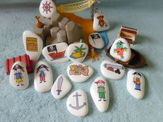 15 lovely hand painted pirate story stones in a navy and white spotty handmade drawstring bag!