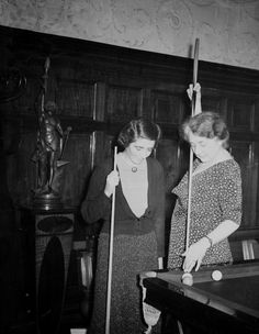 Would be cool to decorate with old photos of pool players, especially women!  The Women's Billiard Championship has commenced at Burroughs & Watts Hall in Soho Square, London. Picture shows Mrs V McDougall of London, the champion, making a masse shot watched by her opponent, Mrs G Holman, also of London. 1938.
