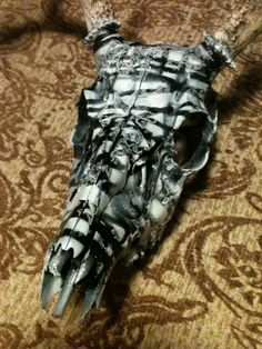 By: Mario Caballero = a close up. Of my latest piece. Deer skull.