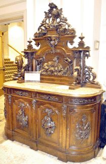 Victoria Low Boy. This is a clear example of the intricate carving that was favored during the Victorian era.