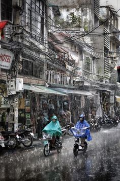 Sudden downpour on 'Old Quarter' Hanoi, Vietnam