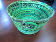This is a beautiful scrappy fabric coiled basket. The size is 8 diameter, 5 3/4 at the base, and 5 tall. This basket is a great and pretty catch-all. I use 100% cotton fabric wrapped around cotton cording and then stitch it lovingly together with an accent thread. The basket is exactly as you see it in the photos. The colors is used are mostly shades of green, blue-green, olive green.....but all my baskets are very scrappy so there are other colors lurking in there.  I have other sizes a... Making Baskets, Coil Pots, Shades Of Green, Olive Green, Cotton Fabric, Diy Projects, Base, Stitch, Colors