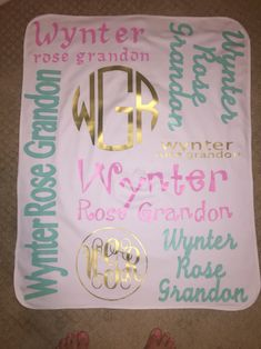 Girls baby blanket made with heat transfer vinyl (HTV), my silhouette cameo, and heat press.  Mint, gold, and bubblegum pink vinyls used.