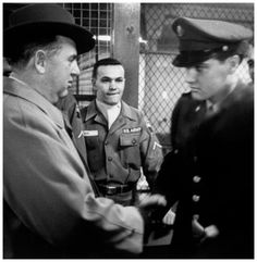 Elvis and the Colonel shake hands upon his return from Germany, March 1960. This photo is priceless!!!