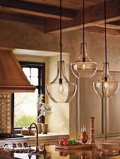 We couldn't help but love the glass pendants adorning this kitchen. What delights you most within your own home?