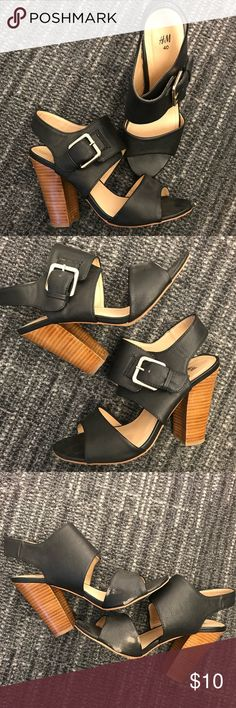 H&M Black Heeled Sandals H&M size 40 (these fit like a size 9- listed as size 9) women's black faux leather heels with wooden stacked heel. Silver buckle details. Scuffs at inside of both footbeds as shown in photo. H&M Shoes Heels