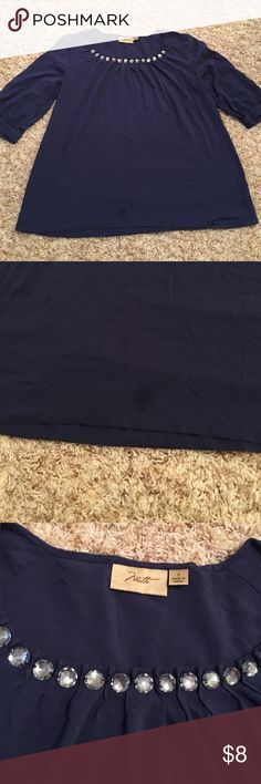 Navy Blue Blouse with Beading One small oil stain. It's not super noticeable in person! This top is gorgeous!! I love the beading/jewels around the neck line. motto Tops Blouses