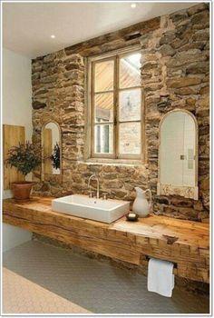 Каменная кладка на стене станет просто отличным дополнением к интерьеру ванной…