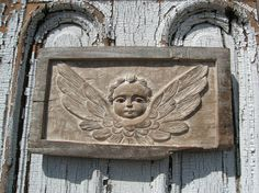 board with carved angel