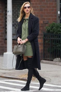 Karlie Kloss wearing Stuart Weitzman Lowland Boots, Balenciaga Papier A4 Mini Tote Bag in Vert Olive, Karlie Kloss x Warby Parker Julia Sunglasses in Heirloom Gold with Copper Fade Lenses, Equipment Remy Short-Sleeve Utility Shirtdress and Blk Dnm Coat
