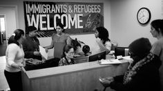 Catholic Charities staff  speak with immigrants  waiting to talk to lawyers. Wyclef Jean, Policy Change, Health Care Reform, Photo Grouping, Cnn Politics, Usa Today, American History, Charity, Catholic