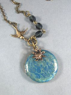 Mermaid Tears,Brass Locket,Patina Locket,Flower,Woodland,Bird,Blue,Teal,Aqua,Ocean. Handmade jewelery by valleygirldesigns on Etsy.. 28.00, via Etsy.