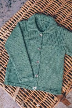 Simple collared jacket with both boys and girls fastening options.