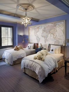 Nautical travel themed bedroom with bluish purple walls, which is a great room for older kids to share.