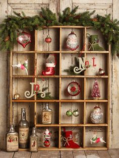 Display your ornaments in a shallow shelf with many small compartments. Photo from Bethany Lowe Designs 2014 Christmas collection. http://bethanylowe.com