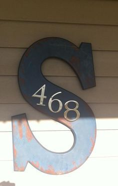 Use the letter from your last name, then put your house number on it. Love this idea and the rustic look for this one!