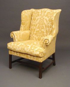 Wingback chair in a great color & pattern...i WANT one of these!!!  The color is PERFECT & so is the pattern.