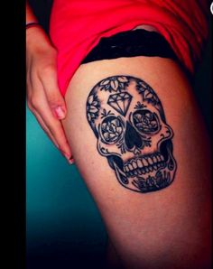 Sugar skull tattoo... love the placement