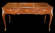 18th Century French Bureau Plat  Antiques: Furniture: Antique Bureau Plat  SKU: MALK273  Best Price: $8,400.00 (USD)    Shipping Continental US: Request Quote  We Ship Worldwide: Request Quote         Payment Policy    Return Policy    Shipping Policy    Ask A Question  18th Century French walnut bureau plat, having a striking patina with satin wood inlays and quality bronze mounts. With three dovetailed drawers and a leather inlaid top, overall this desk is in stunning condition and…