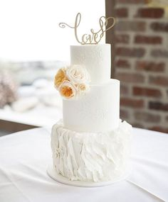 elegant white wedding cake / http://www.deerpearlflowers.com/23-unique-wedding-cakes-made-with-love/