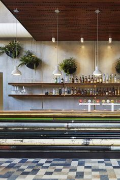 I'm really loving the #reclaimed + repurposed style used for this commercial #bar #interior design!