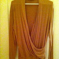 Tan Faux Wrap Top Fitted with banded bottom; can be worn with or without a camisole! 95% Rayon 5% Spandex Jones New York Tops