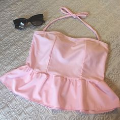 Cute Pink Ruffle Swim Top halter/strapless Light pink swim top only. Has removable halter straps so it can be worn strapless as well.  Has thick removable bra cups.  Very faint mark as seen in last pic.  No size is given but I'd say it would fit a small best.  I'm an XS and it's a little big on me.  Let me know if you have any questions!  Offers welcomed through the offer button top of bust lying flat measures 13.5 inches.  Length 11.5. Material is stretchy Swim