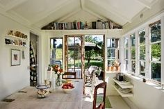 YES! Inspiration for our someday schoolroom converted from an old covered porch off of our livingroom. It has the exposed eaves and everything. I was leaning toward all white, and this confirms it.