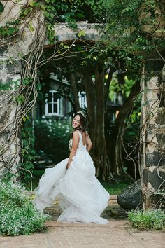 Textural appliques adorn the bodice and float down through the full skirt, crafted from layers of glitter tulle. A plunge neckline adds a sultry edge to the whimsical look, and a removable grosgrain belt defines the waist. Photo: @melialucida Bhldn, Bridal Outfits, Plunging Neckline, Grosgrain, Garden Wedding, Appliques, Veil, Bodice, Whimsical