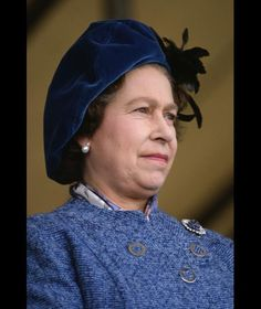 Queen Elizabeth II in Gloucestershire for the horse trials. Queen Elizabeth wore a blue velvet beret as she watches the horse trials.
