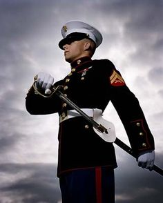 OOHRAH! Marine Corp dress blues are the sexiest of ANY military uniform!! Duh! I married a Marine!