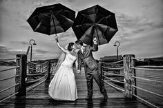 Who says a little rain has to stand in the way of your wedding day fun? Embrace it and snap some adorable photos!