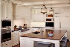Winsome Kitchen Islands With Sink Image Gallery in Kitchen Farmhouse design ideas with Winsome coffered ceiling custom white cabinetry custom white cabinets double ovens farmhouse farmhouse
