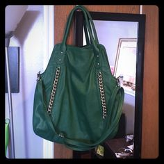 Green Tote Purse Green tote like purse with chain detailing. Never been worn. No tearing or usage indications. Clean inside. No tags. Carlos Santana Bags Shoulder Bags