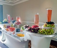 A buffet overflowing with luscious fruits of all types providing refreshment for guests after sitting in the California sun.