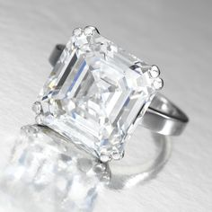 Attractive Diamond Ring. The square step-cut F Color, Internally Flawless diamond weighing 14.52 carats, set on a plain platinum mount.