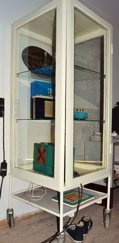 Display cabinet made from old windows and a industrial base
