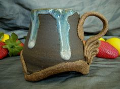 Ceramic Footed Mug in Dusk Purple, Black Mountain and Speckled Brown by Sally Anne Stahl. www.clayshapergallery.com