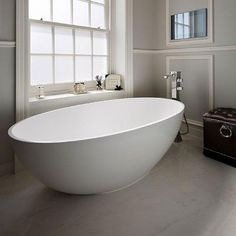 The deep curves of this bath are inspired by Coniston Water in the Lake District, which is set within a steep U-shaped valley. Yet despite its imposing scale, it is a sleek and slender bath.