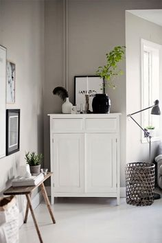 warm, neutral wall color with white, black, and spring green accents