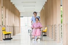 A #nurse in Asia assisting a woman in a #wheelchair. #hospital