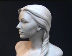 http://www.youtube.com/watch?v=GH5Eri5pGW0 This is a very cool demonstration video by Joanna Mozdzen on how to sculpt a female head out of clay.