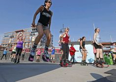 Kangoo Jumps at Canalside is among the new free outdoor fitness classes being offered in the region this summer. (Robert Kirkham/Buffalo News)