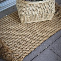 Turn a pile of rope into a lovely jute-like outdoor rug. Perfect for snagging dirt before it enters the home.
