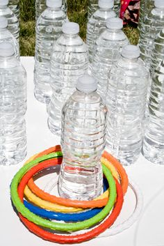 Reuse water bottles by filling them up with water (or colored water) for a ring toss game.