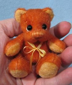 "**Beth Franco Bears** Leo is 2 1/2"" sitting and 3"" tall."